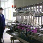 Automātiska rotējošu pudeļu šķidruma iepildīšanas mašīna ar vāciņu